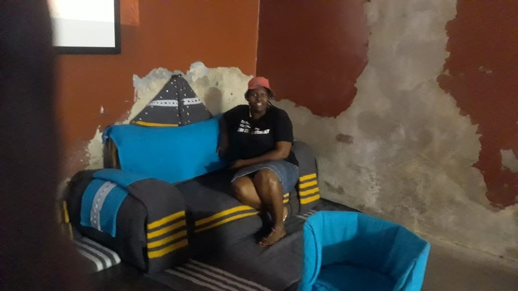 Constitution Hill: Conhill tour guide Lorraine Mhlari testing out the Gang leader's two-seater couch