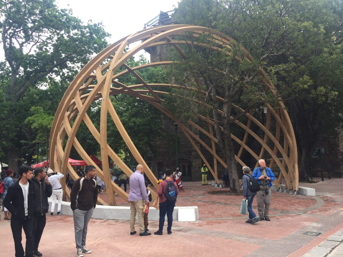 Constitution Hill: People enjoy Arch for Arch, outside Cape Town's St George's Cathedral.