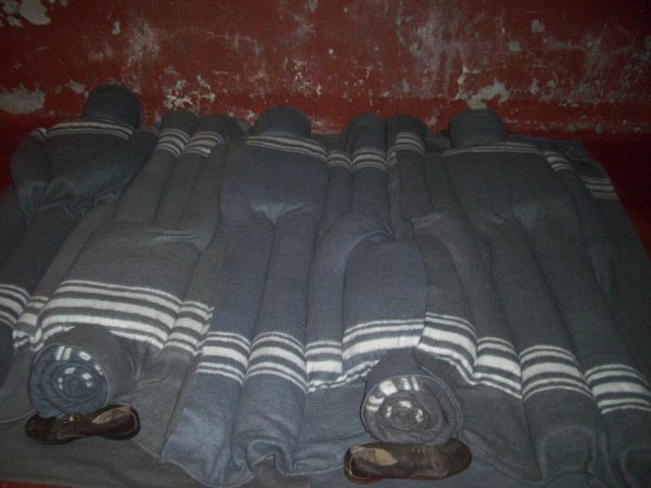 Constitution Hill: Blanket sculptures depicting how prisoners slept packed tightly together in a cell far too small for the number of inhabitants